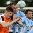 Tough defender: Carrick's Paddy McNally shows his grit against former club Ballymena United earlier in the season