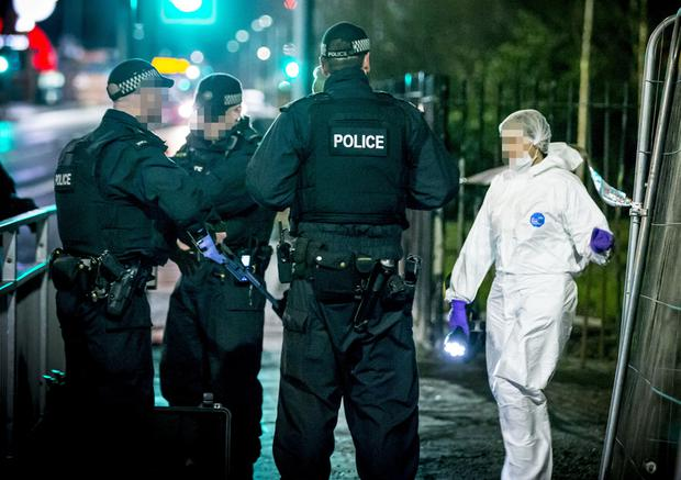 Police officers at the scene of a shooting in the Falls Road area of west Belfast on 15th February 2017 . (Photo - Kevin Scott / Belfast Telegraph)
