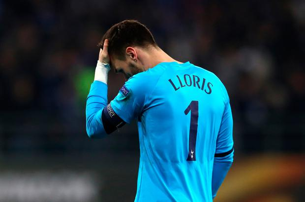 Hugo Lloris of Tottenham Hotspur looks dejected during the UEFA Europa League Round of 32 first leg match between KAA Gent and Tottenham Hotspur at Ghelamco Arena on February 16, 2017 in Gent, Belgium. (Photo by Dean Mouhtaropoulos/Getty Images)