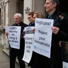 Divisive issue: activists from the Lesbian and Gay Christian Movement hold a vigil outside the General Synod at Church House in London. Photo: Stefan Rousseau/PA Wire