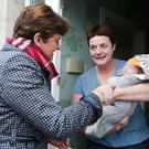 Arlene Foster meets Heather Flemming and her six-week-old nephew Finn on the election trail