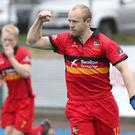 Hot shot: Eugene Magee celebrates his goal against Corinthian in the Irish Senior Cup semi-final