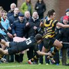 Nice try: Inst 's Joseph Finnegan runs in a try as Campbell's Ben Power attempts a last-ditch tackle
