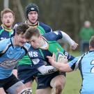 Morale blow: Ballynahinch's Ross Carlisle tries to push forward against Galwegians' Marc Kelly during his side's home defeat