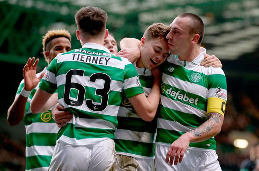 Tough win: James Forrest is congratulated by his team-mates
