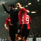 Hero worship: Zlatan Ibrahimovic celebrates scoring the winner with United fans