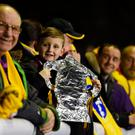 A young fan poses with a tin foil FA Cup in the stadium before the Emirates FA Cup fifth round match between Sutton United and Arsenal on February 20, 2017 in Sutton, Greater London. (Photo by Mike Hewitt/Getty Images)