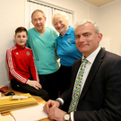 Helping hand: Injured boxing youngster Eoghan Quinn with Dr Andrew Crone, Dame Mary Peters and consultant Mr Michael Eames