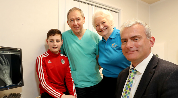 Helping hand: Injured boxing youngster Eoghan Quinn with Dr Malcolm Crone, Dame Mary Peters and consultant Mr Michael Eames