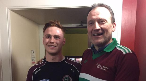 Glory days: Current captain Conor Meyler with St Mary's 1989 captain John Reihill, with his original jersey during the celebrations