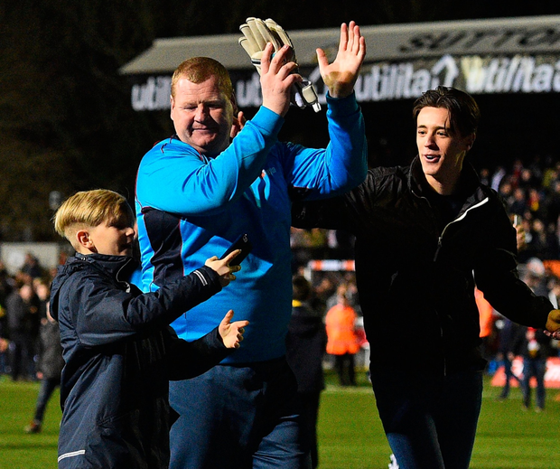 Sutton United's English goalkeeper Wayne Shaw (C) as he applauds supporters on the pitch after the English FA Cup fifth round football match between Sutton United and Arsenal at the Borough Sports Ground, Gander Green Lane in south London on February 20, 2017. AFP/Getty Images