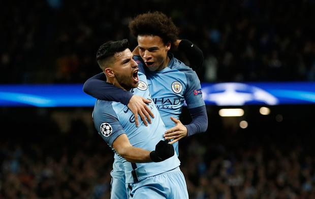 Manchester City's Sergio Aguero celebrates scoring his sides second goal with Leroy Sane during the UEFA Champions League match at the Etihad Stadium, Manchester. PA
