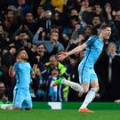 Hitting back: John Stones scores for Manchester City in the 5-3 victory