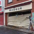 Damage to the Windsor bakery's shutters after Beattie's car ploughed into them