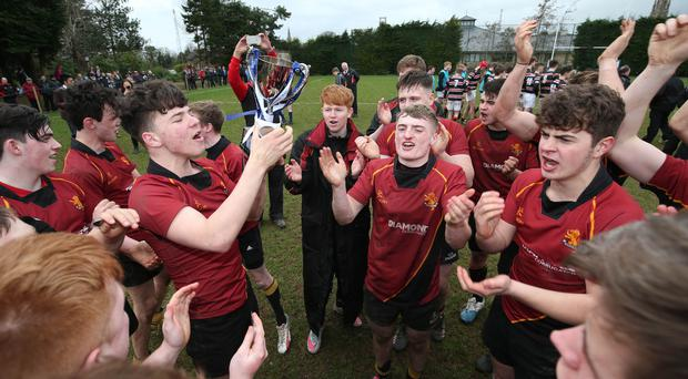 Champions: Foyle College captain Thomas Cole celebrates winning the Danske Bank Schools' Trophy