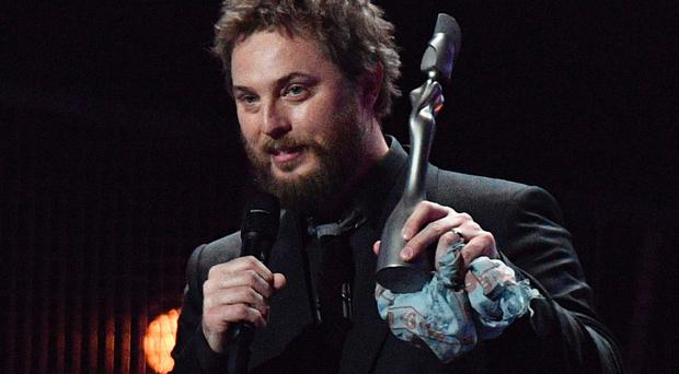 David Bowie's son, Duncan Jones collects the award for British album of the year on behalf of his late father for 'Blackstar' during the BRIT Awards 2017 ceremony