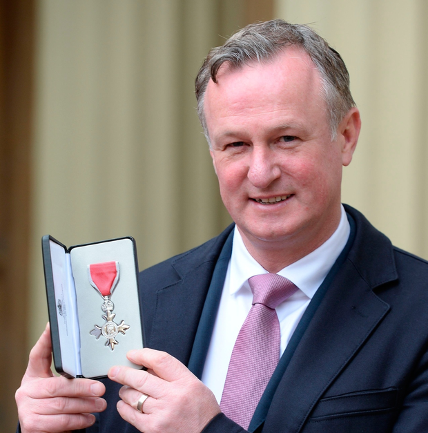 Northern Ireland manager Michael O'Neill poses with his medal after being appointed a Member of the Order of the British Empire (MBE) by Britain's Queen Elizabeth II at an investiture ceremony at Buckingham Palace in London on February 23, 2017. AFP/Getty Images