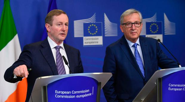 President of Commission Jean-Claude Juncker (R) and Irish Prime minister Enda Kenny (L) give a joint press conference following their meeting at the European Union headquarters in Brussels on February 23, 2017. AFP/Getty Images