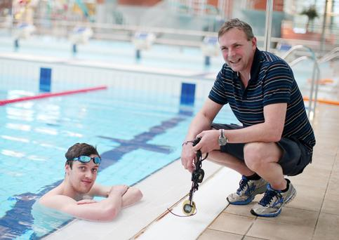Success story: Jordan Sloan, who won gold in the British Universities 200m freestyle, with his trainer Paul Dennis