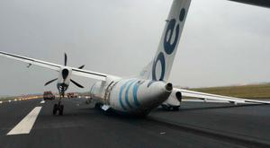 Photo taken with permission from the Twitter feed of David Fleming Jnr @OfficialDavid7 of a Flybe plane from Edinburgh that was evacuated after its landing gear collapsed on arrival at Amsterdam's Schiphol Airport. PA