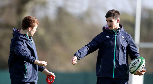 Handover: recalled Jonathan Sexton (right) and displaced Paddy Jackson in training after yesterday's team announcement at Carton House