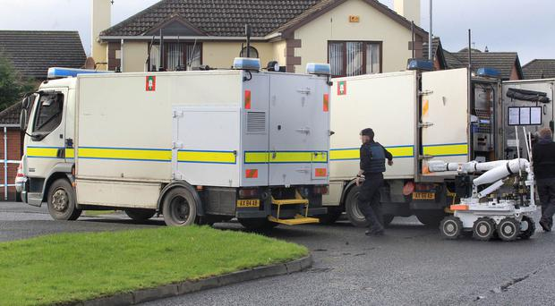 PSNI and Army experts at the scene of the murder bid in Londonderry on Wednesday
