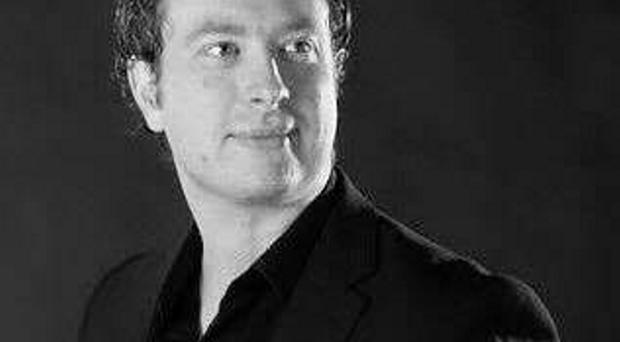 Hitting the right notes: Baritone Karl McGuckin