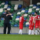 Drawing comfort: Portadown players and manager Niall Currie (left) celebrate their hard earned point against Linfield. Photo: Brian Little/Presseye