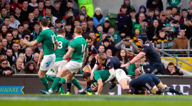 Ireland's Conor Murray scores the game's sole try during the RBS 6 Nations match at the Aviva Stadium, Dublin on Saturday February 25, 2017. Niall Carson/PA Wire