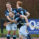 On the mark: Daniel Buser celebrates his goal with Jonathan Bell and Ryan Getty against C of I