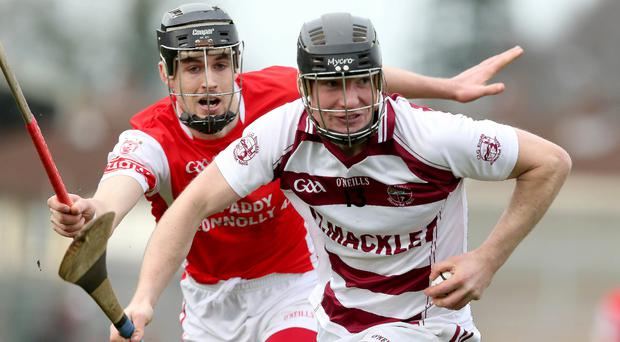 Powerplay: Cuala's Sean Moran tries to get to grips with Se McGuigan of Slaughtneil at the Athletic Grounds on Saturday