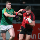 Mourne march: Down's Peter Turley holds off Bryan Menton of Meath