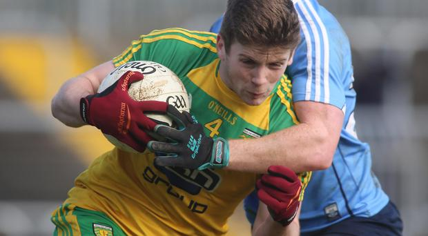Gripping: Donegal's Eoin Ban Gallagher with Conor McHugh