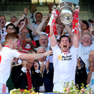 Glory days: Sean Cavanagh lifts The Anglo Celt Cup last year but in order for Tyrone to win an All-Ireland they will have to play two extra games under the new championship structures