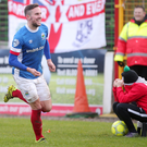 Can't watch: A Glentoran ball boy is less than impressed as Andy Waterworth celebrates his goal