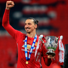 Silver lining: Zlatan Ibrahimovic celebrates with the EFL Cup after his late header