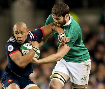 Hend game: Ulster and Ireland forward Iain Henderson tackles France's Gaël Fickou during the Six Nations clash at the Aviva Stadium on Saturday