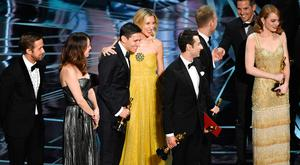 Actors Ryan Gosling and Rosemarie DeWitt, composers Benj Pasek and Justin Hurwitz, and actress Emma Stone look on as 'La La Land' wins Best Picture due to a presentation error (later corrected to 'Moonlight') onstage during the 89th Annual Academy Awards at Hollywood & Highland Center on February 26, 2017 in Hollywood, California. (Photo by Kevin Winter/Getty Images)