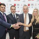 Ahmad Jaber (Glengormley manager), Vladislav Opanov (Stranmillis manager), Errol Jenkins and wife Avril with the award for best kebab house in Northern Ireland. Picture: Mehmet Er