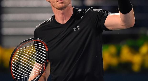 Thumbs up: Andy Murray breezed into the second round