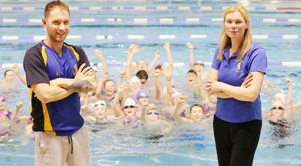 Making a splash: Members of Bangor Swimming Club at the Aurora Centre with coaches James Hand and Sharlene Urry