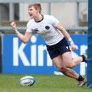 Final call: Methody's James McConnell celebrates scoring a try to help his school seal a final showdown with RBAI