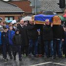 Mourners at the funeral of Conan Anderson in Short Strand yesterday