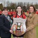 Proud moment: Captain Orla Thompson receives the trophy from Liz Lamont (Ulster President) and Sarah Little (Belfast Telegraph)