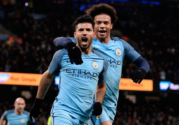Manchester City's Argentinian striker Sergio Aguero (L) celebrates scoring his team's second goal during the FA Cup fourth round replay football match between Manchester City and Huddersfield Town at the Etihad Stadium in Manchester, north west England, on March 1, 2017. AFP/Getty Images