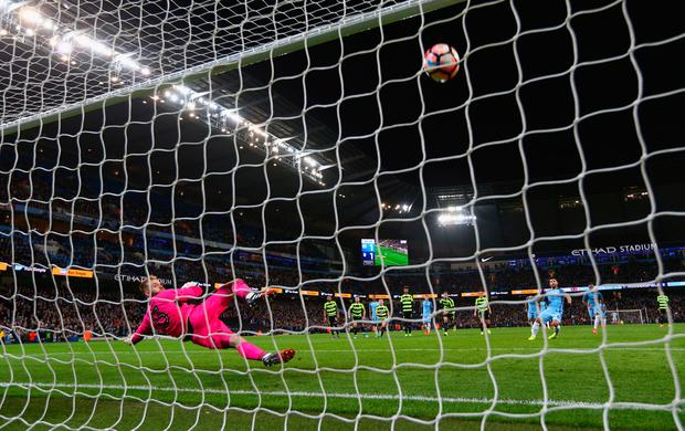 Sergio Aguero of Manchester City scores their second goal from a penalty past goalkeeper Joel Coleman of Huddersfield Town during The Emirates FA Cup Fifth Round Replay match between Manchester City and Huddersfield Town at Etihad Stadium on March 1, 2017 in Manchester, England. (Photo by Clive Brunskill/Getty Images)