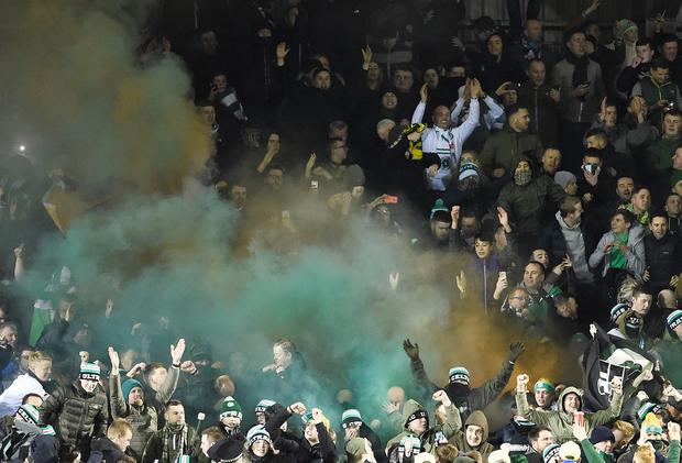 Celtic fans celebrate with smoke bombs after Scott Sinclair scored the opening goal during the Ladbrokes Scottish Premiership match at the Tulloch Caledonian Stadium, Inverness. PA