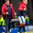 Relief: Caretaker manager Graeme Murty and Martyn Waghorn celebrate Rangers' late win