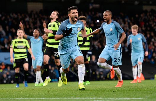 Class act: Sergio Aguero celebrates the first of his two goals for Manchester City last night at the Etihad