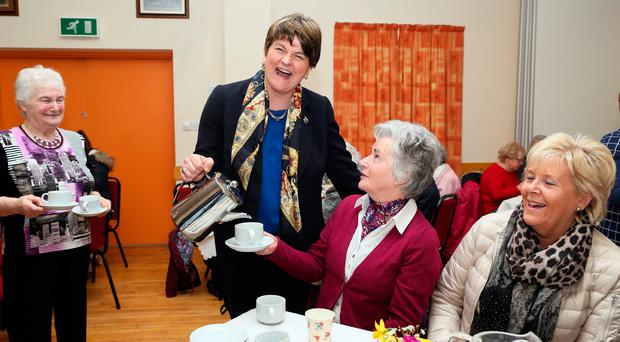 DUP leader Arlene Foster joins locals for lunch at the Moree Orange Hall near Cookstown on the final day of campaigning yesterday